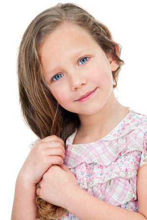 innocent girl: Close up Portrait of cute little girl with innocent look  Isolated on white background