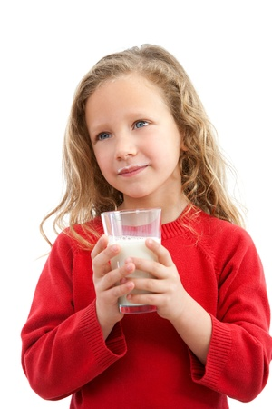 Portrait of cute little girl holding glass of milk  Isolated on white background Stock Photo - 12671691