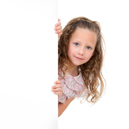 Close up Portrait of little girl holding copy space  Isolated on white background Stock Photo - 12671653