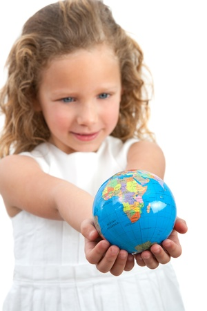 Close up of cute little girl looking at earth sphere Focus point on earth Isolated on white background  photo