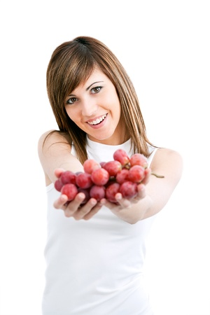 Young healthy attractive woman holding red grapes.Isolated Stock Photo - 13112112