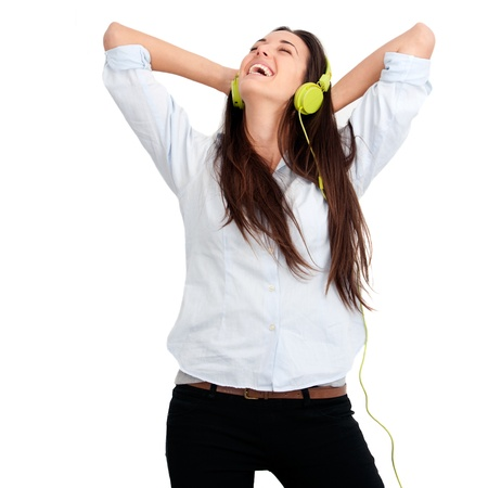Young woman feeling happy listening music with headphones.Isolated. photo
