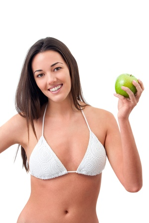 Young attractive woman holding green apple.Isolated Stock Photo - 13112143