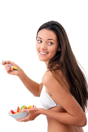 Young attractive woman holding fruit bowl.Isolated Stock Photo - 13112100