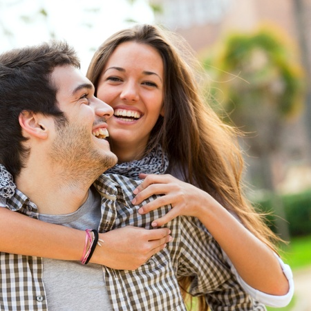 people laughing: Close up portrait of happy laughing couple having fun outdoors