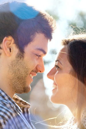 Extreme Close up portrait of romantic couple looking at each other outdoors  Stock Photo - 13112216