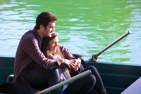Close up portrait of romantic couple boating on river