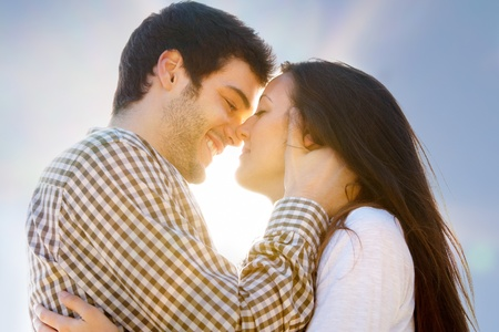 Close up portrait of young couple showing affection outdoors Stock Photo - 13112175