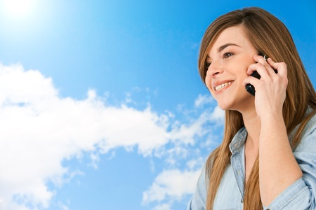 Close up portrait of cute girl talking on cellphone outdoors  Stock Photo - 13203001