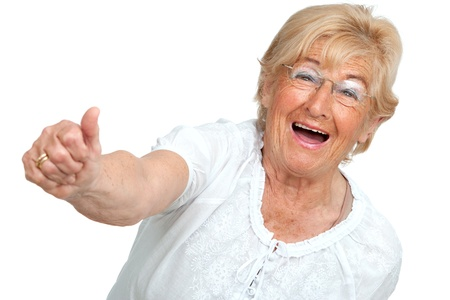 contentedness: Happy senior woman showing thumbs up Isolated on white