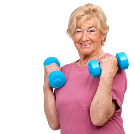 Portrait of healthy senior woman doing workout with weights Isolated on white  photo