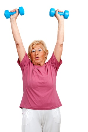 sport wear: Portrait of healthy senior  woman raising arms with weights Isolated on white