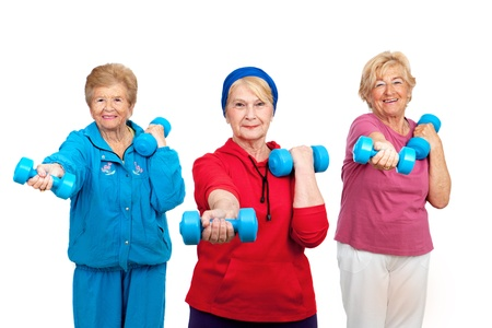 weight weightlifting: Three healthy senior women doing workout with weights Isolated on white  Stock Photo