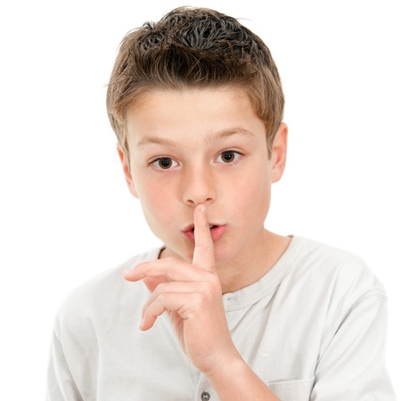Cllose up portrait of boy with finger on lip demanding silence .isolated on white background Stock Photo - 13686896