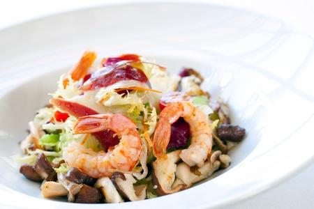 seafood salad: Close up shrimp salad with mushrooms and lettuce.