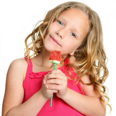 Close up Portrait of cute little girl holding red candy rose  Isolated on white background  Stock Photo - 13976316