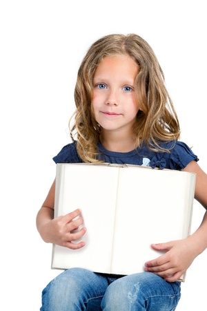 Little girl pointing with finger on blank book with copy space  Isolated on white background Stock Photo - 13976321