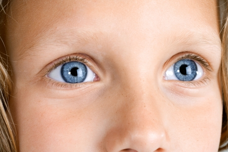 Macro Close up portrait of young girls blue eyes   photo