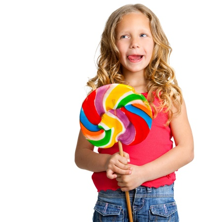 lollipops: Portrait of cute girl holding huge colorful candy Isolated on white  Stock Photo