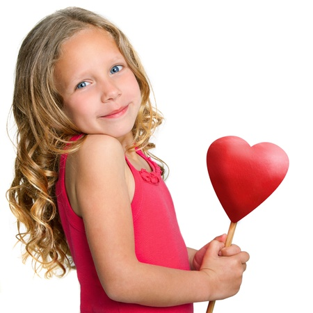 Close up Portrait of cute little girl holding red heart Isolated on white background Stock Photo - 13976307