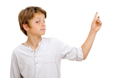 Boy with funny face expression pointing with finger at blank space Isolated on white  photo