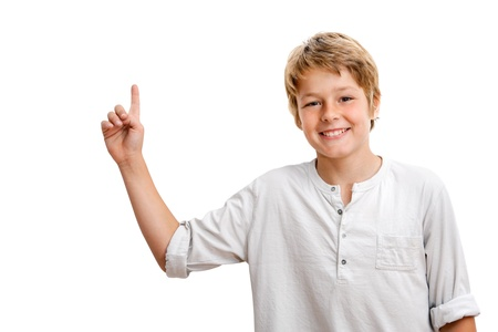 Handsome Boy pointing at blank copy space Isolated on white  photo