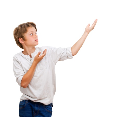 Young Boy pointing with hands at blank copy space Isolated on white  photo