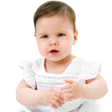 Portrait of cute little baby girl with funny face expression  Isolated on white background Stock Photo - 14174466