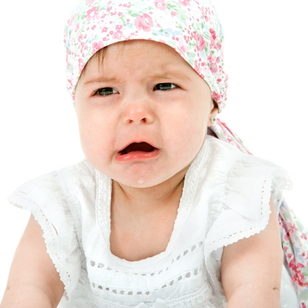 cheerless: Close up Portrait of cute little baby girl with sad face expression  Isolated on white background  Stock Photo