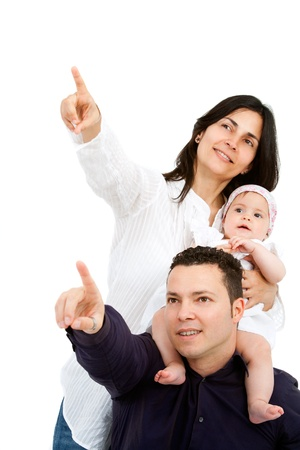 Portrait of young couple with their baby daughter pointing at copyspace  Isolated on white background Stock Photo - 14174491