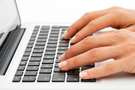 online transaction: Macro close up of female hands on laptop keyboard