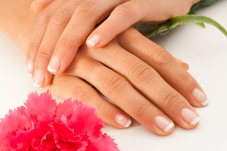 Extreme close up of female hands with french manicure  Stock Photo