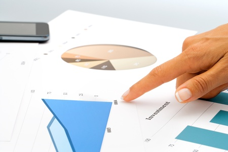 Close up of female hand pointing on investment documents Stock Photo - 14260556
