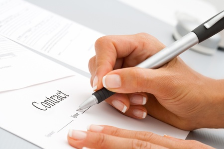 Macro Close up of female hand signing a contract  Stock Photo