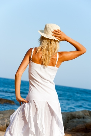Young woman in white dress looking in the distance  photo