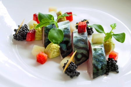 Macro close up of grilled mackerel fish with blackberries and avocado dressing  photo