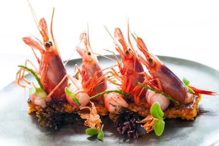 Macro close up of King prawns with crisp seafood rice  Stock Photo