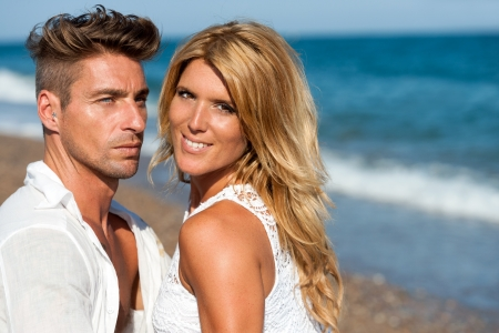 sexy couple on beach: Close up portrait of handsome couple in white on beach