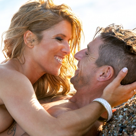 Close up portrait of handsome couple on beach about to kiss Stock Photo - 15388570