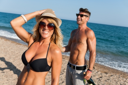 tattooed: Hansome couple enjoying afternoor sun on beach