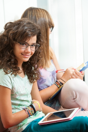 High school student: Portrait of young student sitting with digital tablet