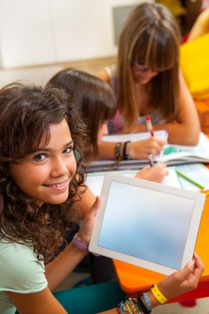 Portrait of cute student holding digital tablet with free copy space Stock Photo - 15432222