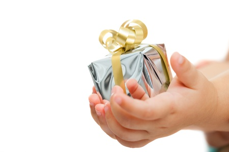 Macro close up of babies hands holding small present.Isolated on white background. photo