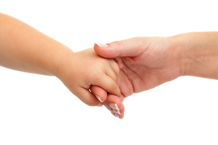 touching hands: Close up of baby hand holding mothers hand. Isolated on white background. Stock Photo