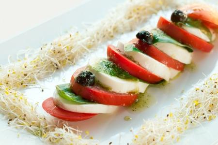 caprese salad: Close up of italian mozzarella and tomato caprese salad.