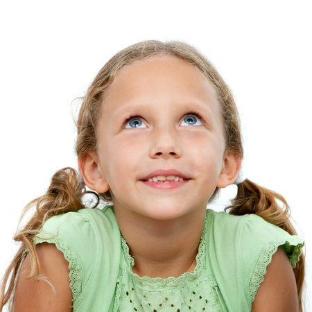 Close up portrait of cute little girl looking up.Isolated on white background. Stock Photo - 16247889