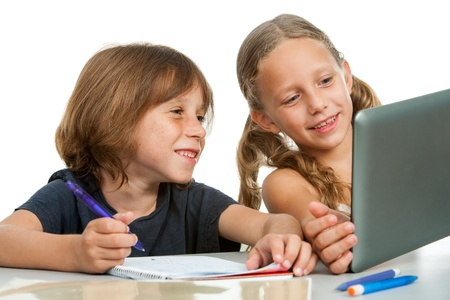 school notebook: Close up portrait of cute girl showing classmate homework on tablet. Isolated.