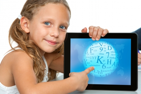kid pointing: Close up portrait of cute girl touching ditital tablet screen Isolated on white
