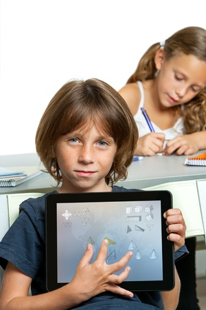 Close up of young boy student showing math symbols on digital tablet screen Isolated photo