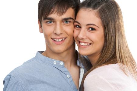 pareja de adolescentes: Close up retrato de feliz guapo couple.Isolated en blanco. Foto de archivo